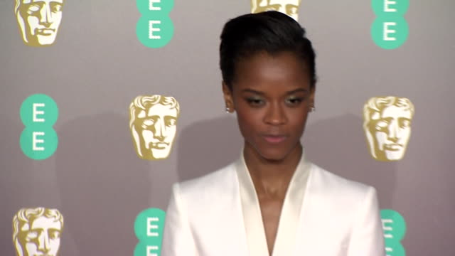 letitia wright poses for photos on red carpet at bafta film awards at royal albert hall - letitia wright stock videos and b-roll footage