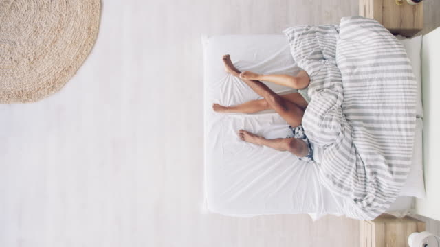 lets crawl under the blankets for some loving - duvet stock videos & royalty-free footage