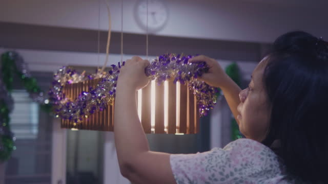 let's get these christmas decorations - electric lamp stock videos & royalty-free footage