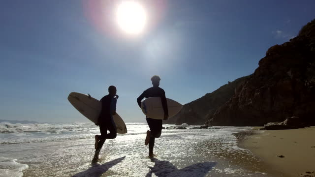 lets go and surf - surfing stock videos & royalty-free footage