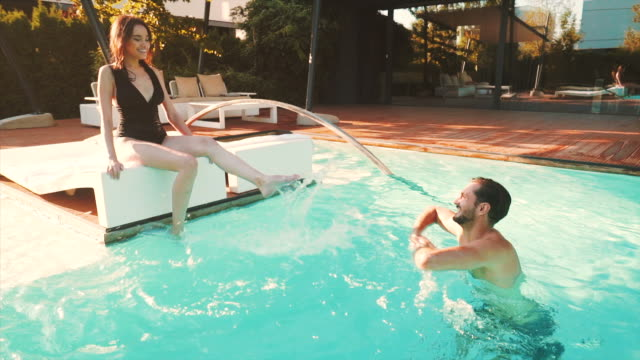 let`s have some fun at the swimming pool. - romantic activity stock videos & royalty-free footage
