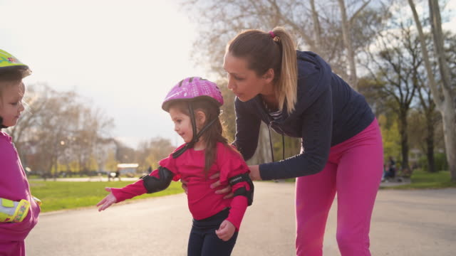 let's learn how to skate, sister! - elbow pad stock videos & royalty-free footage