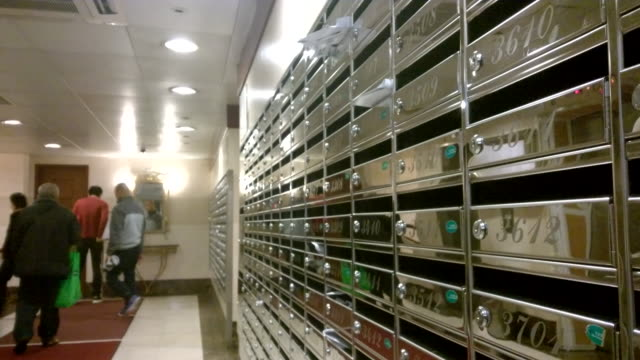 letter mailing box and residents at a building lobby - letterbox stock videos & royalty-free footage