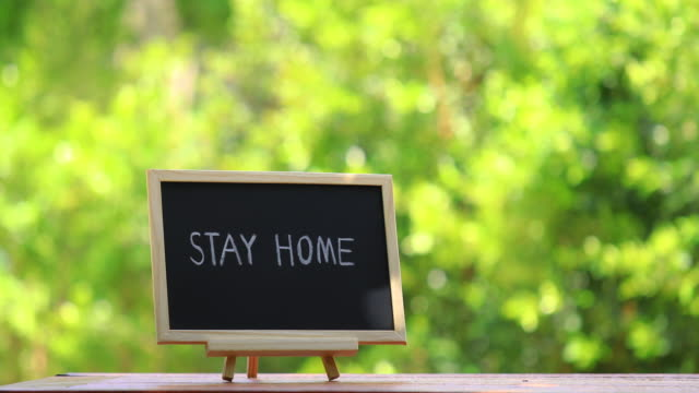 stay home lettering on black chalkboard. covid-19 coronavirus concept background. - plaque bacteria stock videos & royalty-free footage