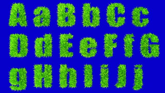 Lettere da A A J con ondeggiare erba.