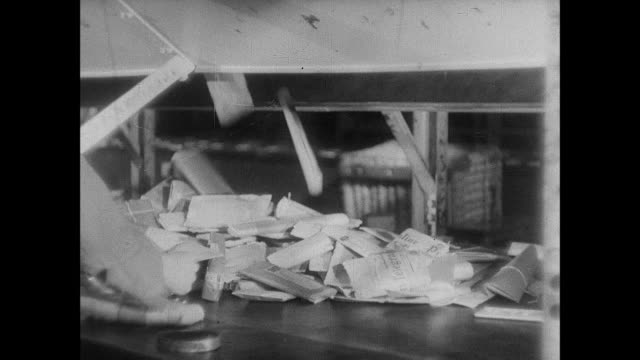 stockvideo's en b-roll-footage met montage letters are sorted at the post office / london, england, united kingdom - 1938