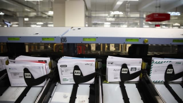 Letters move through an automated sorting machine at the Mount Pleasant post sorting office operated by Royal Mail Plc in London UK on Wednesday July...