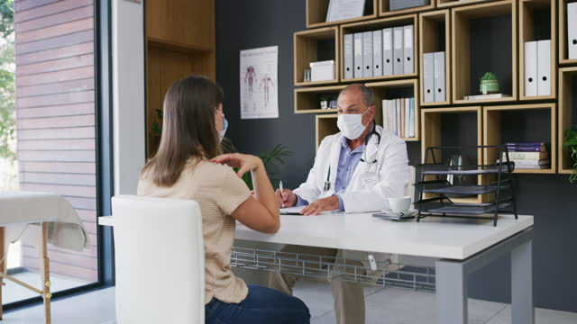 letting the doctor know about all her healthcare concerns - medical record stock videos & royalty-free footage