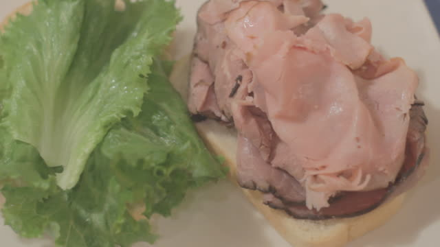 lettuce, tomatoe on top of ham and roast beef - roast beef sandwich stock videos & royalty-free footage