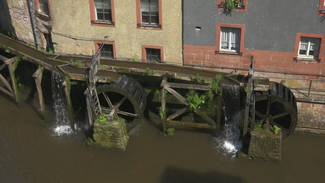 leukbach river at hackenberger mill in the old town of saarburg, rhineland-palatinate, germany, europe - water wheel stock videos and b-roll footage