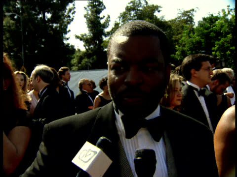 levar burton talks to reporters on the red carpet at the 50th annual emmy awards. - var bildbanksvideor och videomaterial från bakom kulisserna
