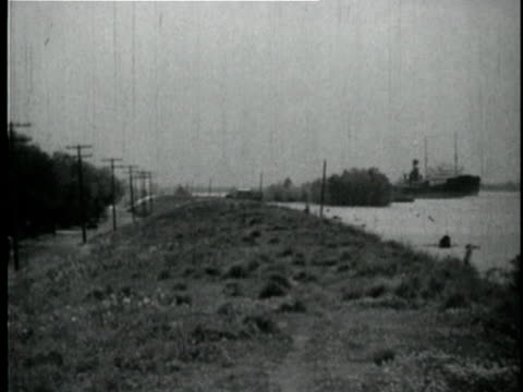 1929 b/w montage levees along mississippi river / new orleans, louisiana - levee stock videos & royalty-free footage