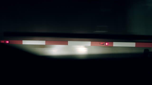 ws level crossing barrier at night - level crossing stock videos & royalty-free footage