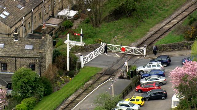 level crossing gates opening - Aerial View - England,  Bradford,  United Kingdom