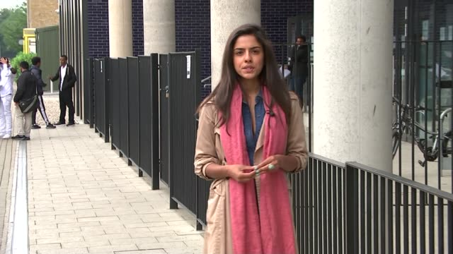 level results released; england: london: ext girl looking at a-levels results male students looking at results woman hugging student 'roza' who has... - 僧衣点の映像素材/bロール