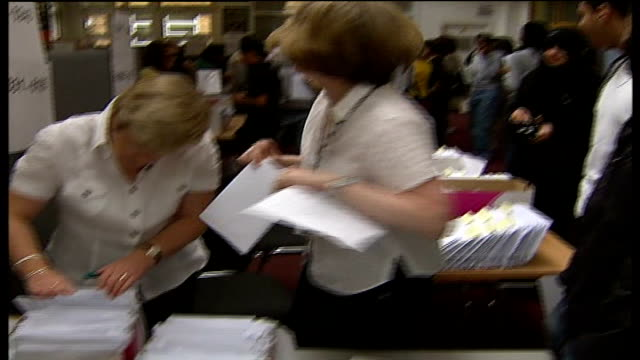 a level students receiving results in richmond college england london richmonduponthames int school workers looking thru results in box handing... - richmond upon thames stock-videos und b-roll-filmmaterial