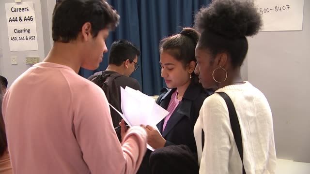 Drop in number of students receiving the highest grades ENGLAND London Newham Sixth Form College INT Students discussing A Level results
