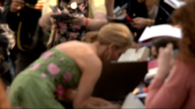 Leveson Inquiry into media ethics and phone hacking JK Rowling and Sienna Miller testify EXT JK Rowling signing autographs on red carpet at...