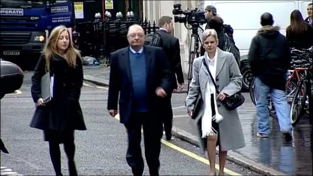 leveson inquiry into media ethics and phone hacking: steve coogan gives evidence; ext margaret and jim watson along - steve watson stock videos & royalty-free footage