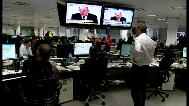 report published future for the press england london financial times int journalists in the newsroom of the financial times watching television... - conference phone stock videos & royalty-free footage
