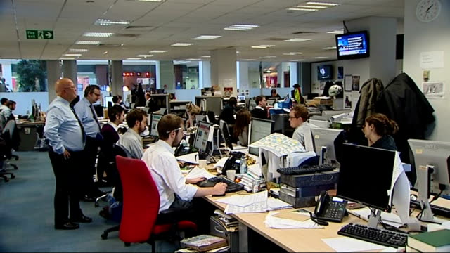 the independent newspaper offices england london the independent int clock on wall showing 130 / journalists in open plan office watching live... - open plan stock videos and b-roll footage