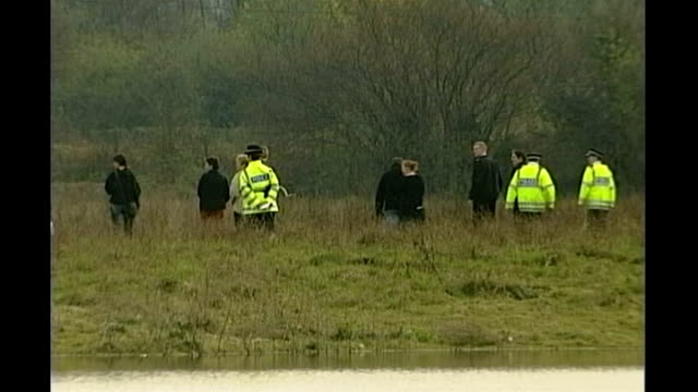 levi bellfield convicted of milly dowler's murder; tx 24.3.2002 surrey: walton-on-thames: ext shots of police searching field tx 20.9.2002 hampshire:... - levi's stock videos & royalty-free footage