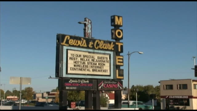 ZI Lewis Clark Motel sign with traffic behind / Montana United States