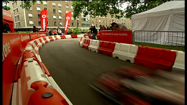 lewis hamilton crashes go-kart during charity race / hamilton interview; england: london: brunswick square: ext chequered flag goes down as lewis... - go cart stock videos & royalty-free footage