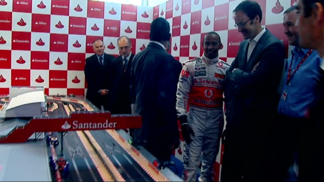 f1 lewis hamilton racing toy car england london int lewis hamilton along corridor and into room to meet press/ lewis hamilton racing remotecontrolled... - remote controlled stock videos and b-roll footage