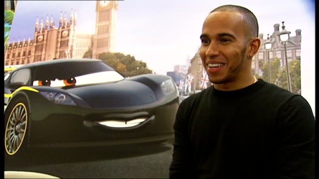 lewis hamilton visits children at great ormond street hospital to promote new film 'cars 2' hamilton interview sot no [not part of hollywood] i am... - tag 2 stock-videos und b-roll-filmmaterial