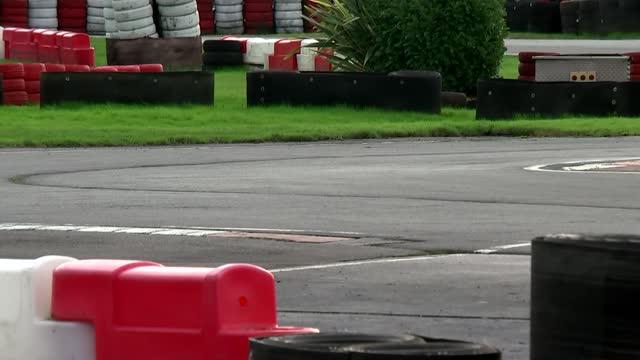 lewis hamilton wins seventh world title to equal schumacher's record; england: hertfordshire: hoddesdon: rye house kart raceway: ext gv sign 'rye... - sports helmet stock videos & royalty-free footage