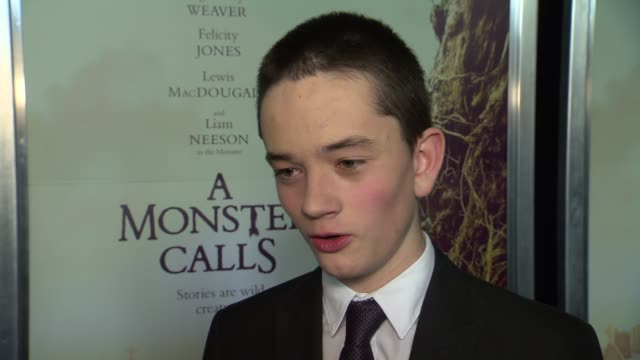 interview lewis macdougall talks about doing motion capture with liam neeson at a monster calls new york premiere presented by focus features at amc... - amc loews stock videos and b-roll footage