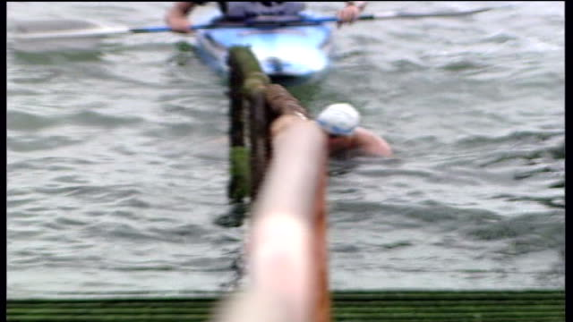 lewis pugh emerging from river thames after swim; england: essex: southend-on-sea: ext onlookers waiting for swimmer lewis pugh on pier, lewis pugh... - swimming trunks stock videos & royalty-free footage