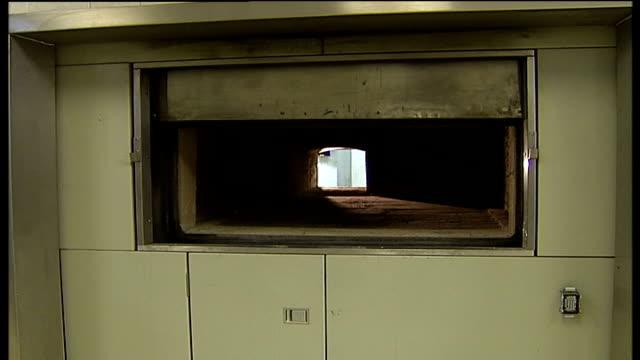 requests to cremate obese bodies lewisham lewisham crematorium door of crematorium furnace closes - pompe funebri video stock e b–roll