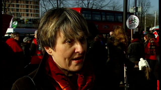 Protesters and interviews ENGLAND London Lewisham EXT Dr Louise Irvine interview SOT Protesters holding '750000 people One A E' and 'Save Lewisham A...