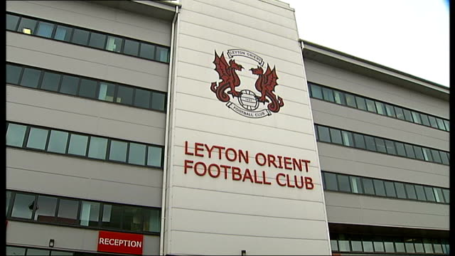 ext name 'leyton orient football club' and logo on front of football club where levene is vicechairman gv exterior of leyton orient fc - leyton orient f.c stock videos and b-roll footage
