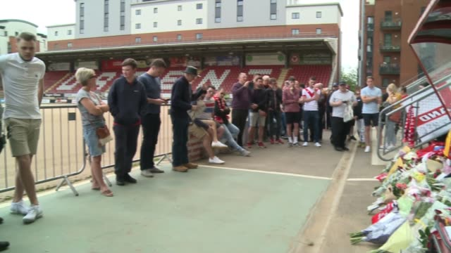 leyton orient manager justin edinburgh dies aged 49 england london leyton brisbane road ext people paying respects in front of floral tributes and... - neckwear stock videos and b-roll footage