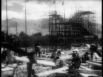 lhasa and the buildings in the capital / workers doing construction - 1959 stock videos & royalty-free footage