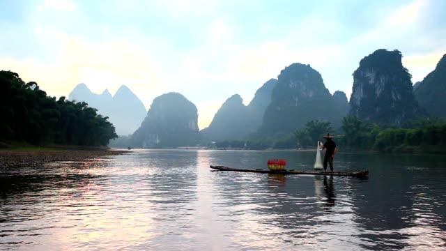 li river fisherman fishing on the li river,xingping,guilin,china - guilin stock videos & royalty-free footage