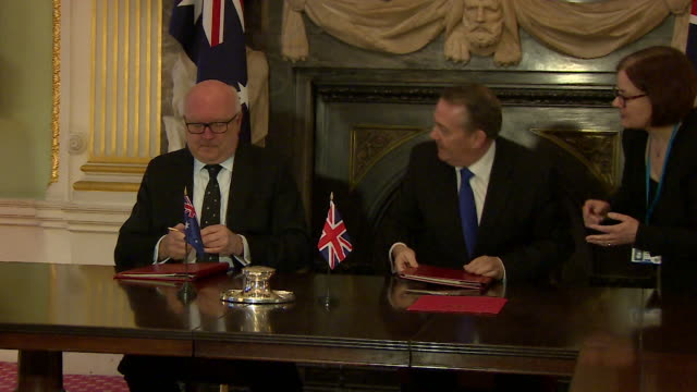 liam fox and australian high commissioner george brandis signing mutual recognition agreement - politician stock videos & royalty-free footage