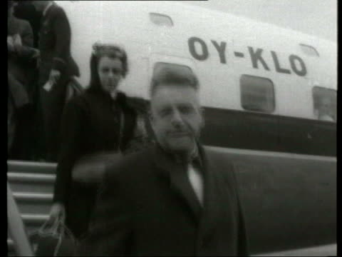 June In 1894 Dr Alfred Kinsey was born London EXT SLOW MOTION Dr Alfred Kinsey disembarking plane LIB INT Liam Neeson interview SOT