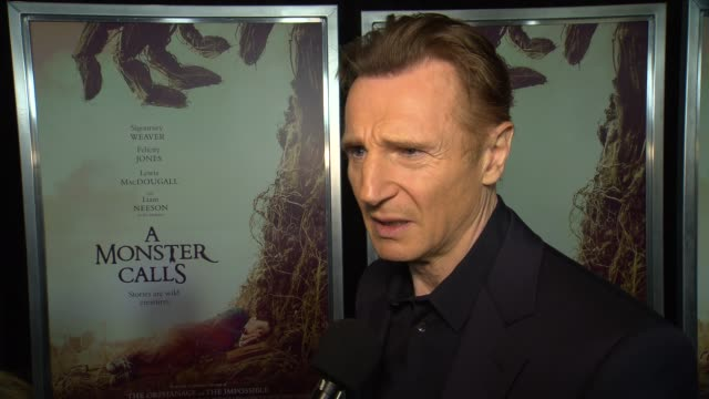 interview liam neeson talks about how much he enjoyed the book that the movie is based on at a monster calls new york premiere presented by focus... - amc loews stock videos and b-roll footage