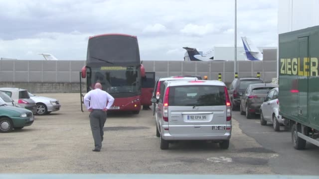 liam payne and zayn malik from one direction band arrived at private airport bourget where a tour bus was waiting for them as well as many fans of... - popular music tour stock videos and b-roll footage