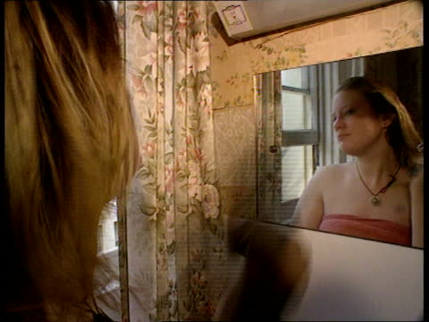 Reaction ITN ENGLAND Brighton CMS Julie Gosling drying hair with hair dryer MS Julie sitting on lower bunk in squashed room Julie looking in bag then...