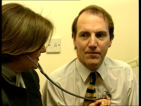 Pre election campaign ENGLAND Emma Nicholson MP visiting GP's surgery with Lib Dem Health spokesman Simon Hughes MP Emma Nicholson using stethoscope...
