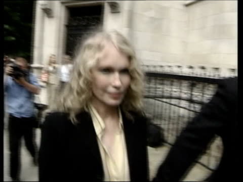 roman polanski action against conde nast england london high court mia farrow along to court - mia farrow stock videos & royalty-free footage