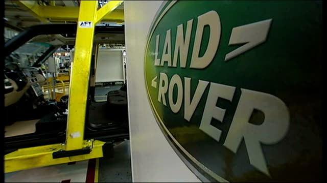 vince cable speech jaguar landrover plant close shot of labels on boxes refocus to assembly line behind worker working on land rover car sign 'land... - land rover stock videos and b-roll footage