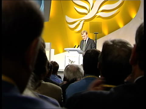 charles kennedy keynote speech itn england sussex brighton seq artist drawing caricature of lib dem leader charles kennedy mp ms charles kennedy onto... - charles kennedy stock videos & royalty-free footage