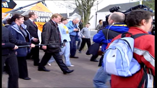 liberal democrat leader sir menzies campbell resigns 2005 charles kennedy mp chatting with lib dem campaigners ext kennedy campaigning on street int... - charles kennedy stock videos & royalty-free footage
