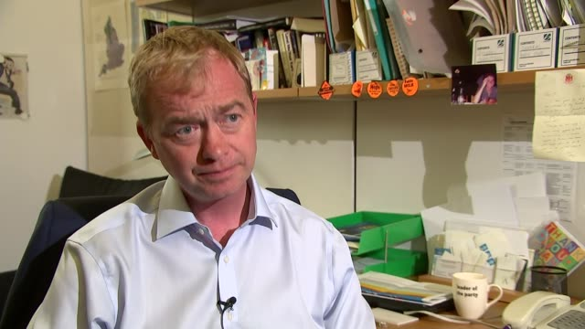 stockvideo's en b-roll-footage met liberal democrat leader tim farron urges disaffected labour mps to defect; england: london: int various of tim farron mp seated in commons office... - home economics